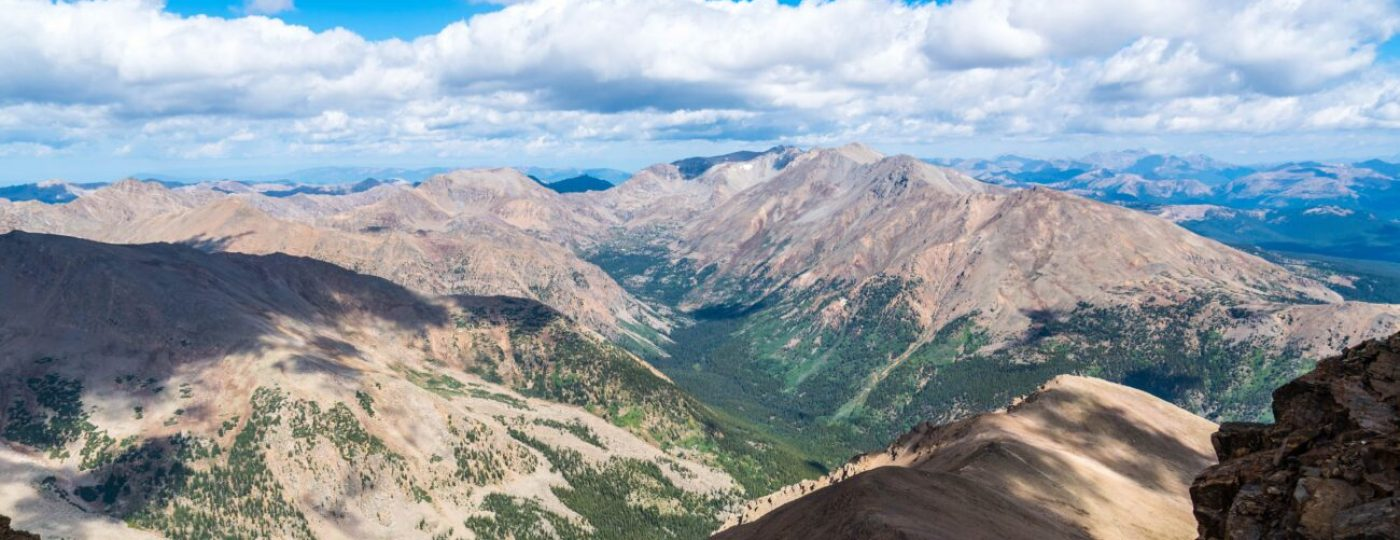The Highest Peak in Colorado - amazing Mountain Climbing view from the summit of Mount Elbert 14er Rocky Mountain Landscape in Summer during August 2018 with huge valley down below