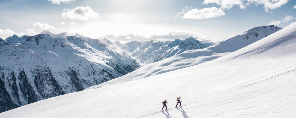 Canva - Two Man Hiking on Snow Mountain